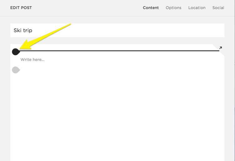 The insert point above the default Text Block in a new blog post.